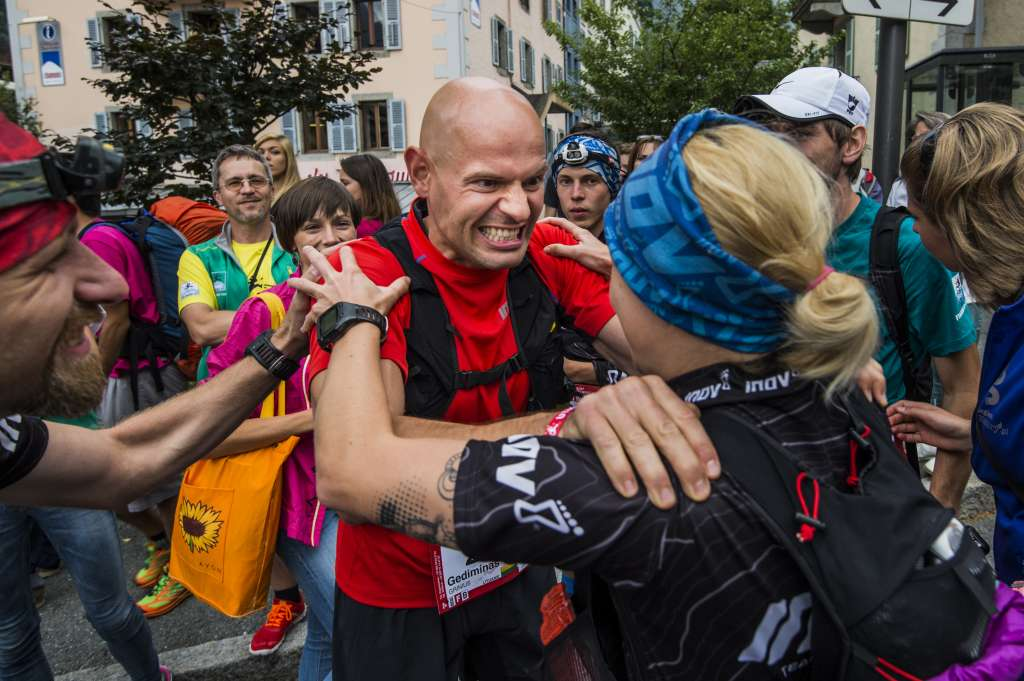 Gediminas Grinius celebrates with members of the Polish inov-8 team after finishing fifth in the 2014 UTMB. Photo by Piotr Dymus