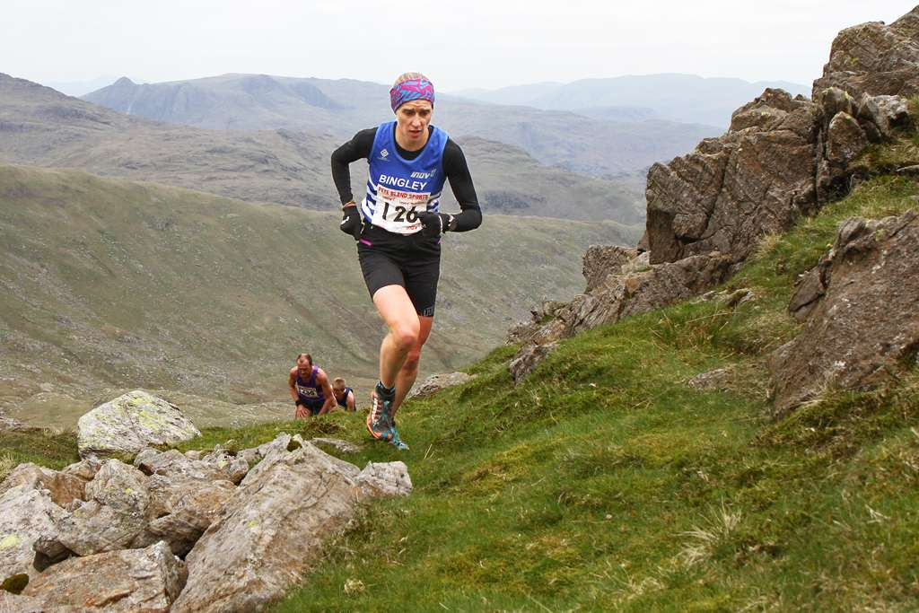 Victoria Wilkinson storming to a new course record at Coniston. Photo by Andy Holden
