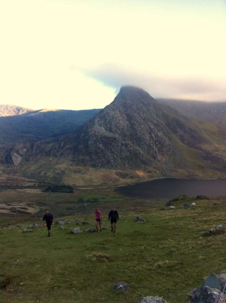 Nicky Spinks, supported by pacers, on her way to setting a new women's record for the Paddy Buckley. Photo by Nick Cable