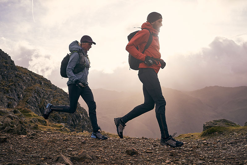 Paul running with Nicky Spinks in the Lake District