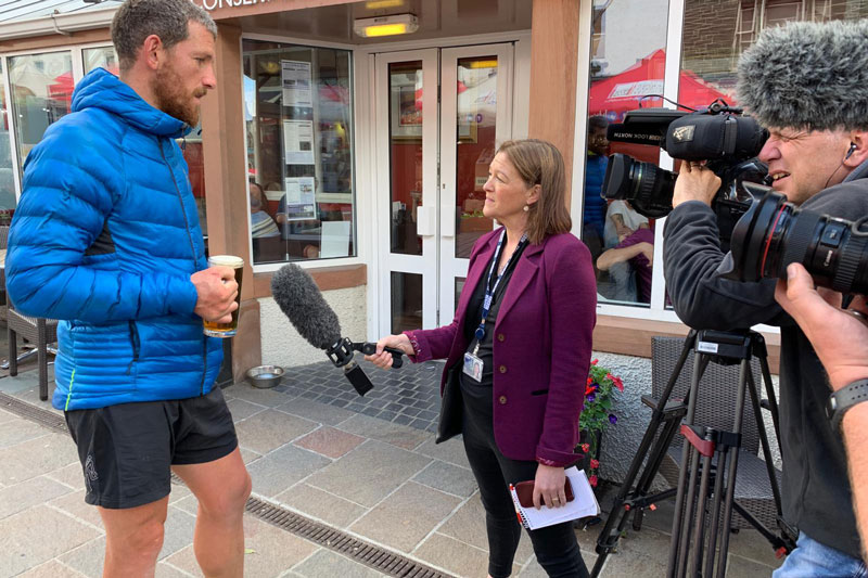 Paul being interviewed by the BBC, just after completing the Wainwrights, with a pint in hand.