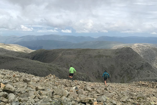 Paul running off Scafell Pike, the highest peak of the Wainwright's, with friend and main support runner, Joe Mann.