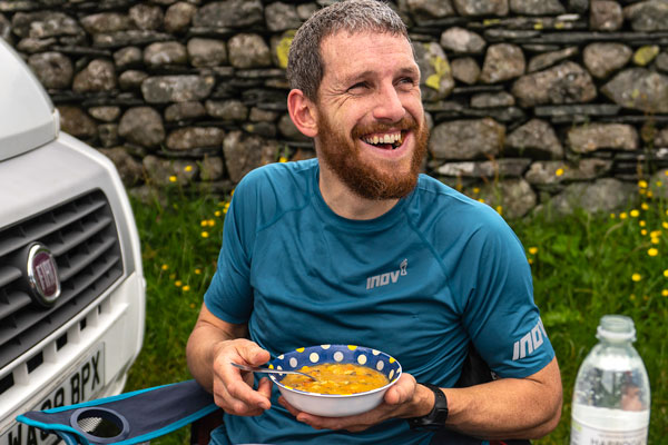 Getting the calories in at a support point earlier on in the challenge | Photo Andy Jackson Photography