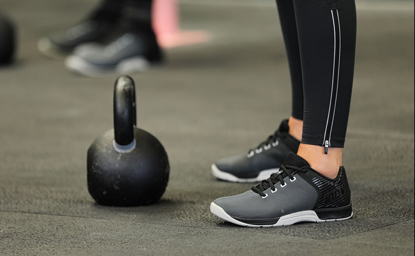Beginners Guide to Crossfit - athlete standing over a kettlebell