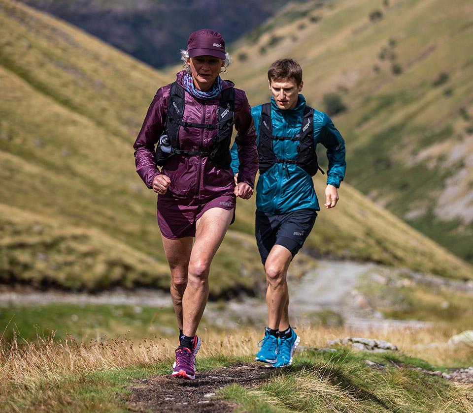 trail runners running up a hill