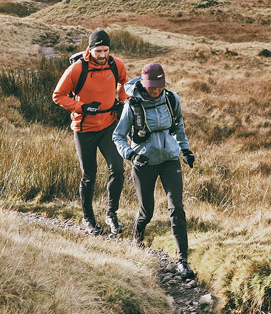 Man and women in inov-8 clothing