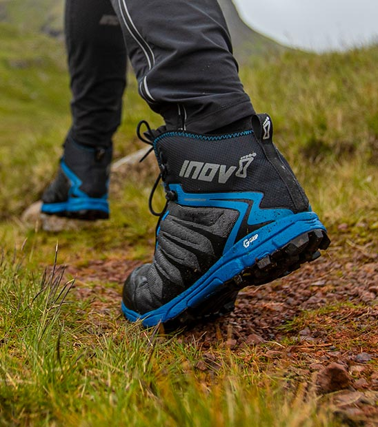 Blue walking boots on grass